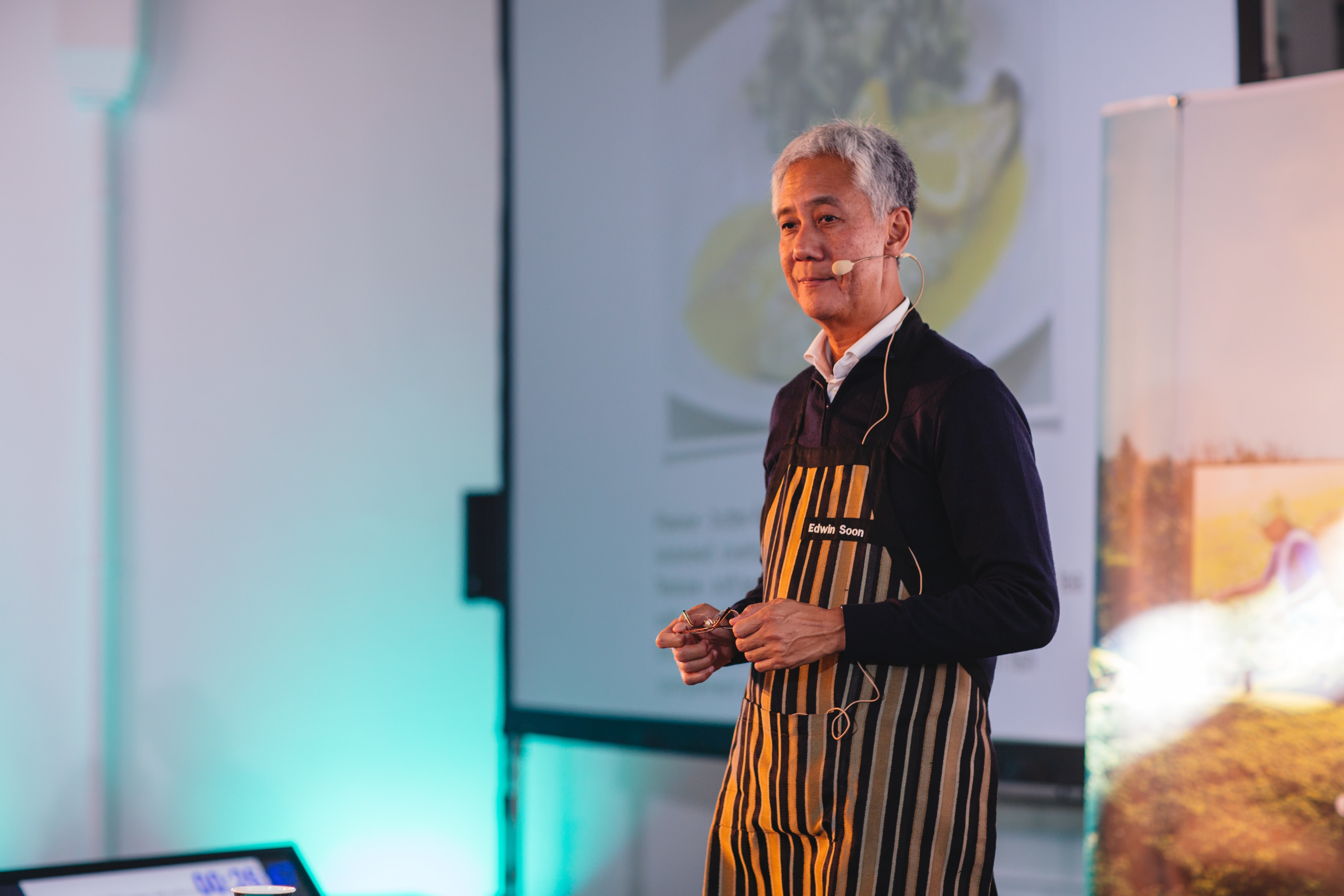 Edwin Soon speaking about tea and food poring.