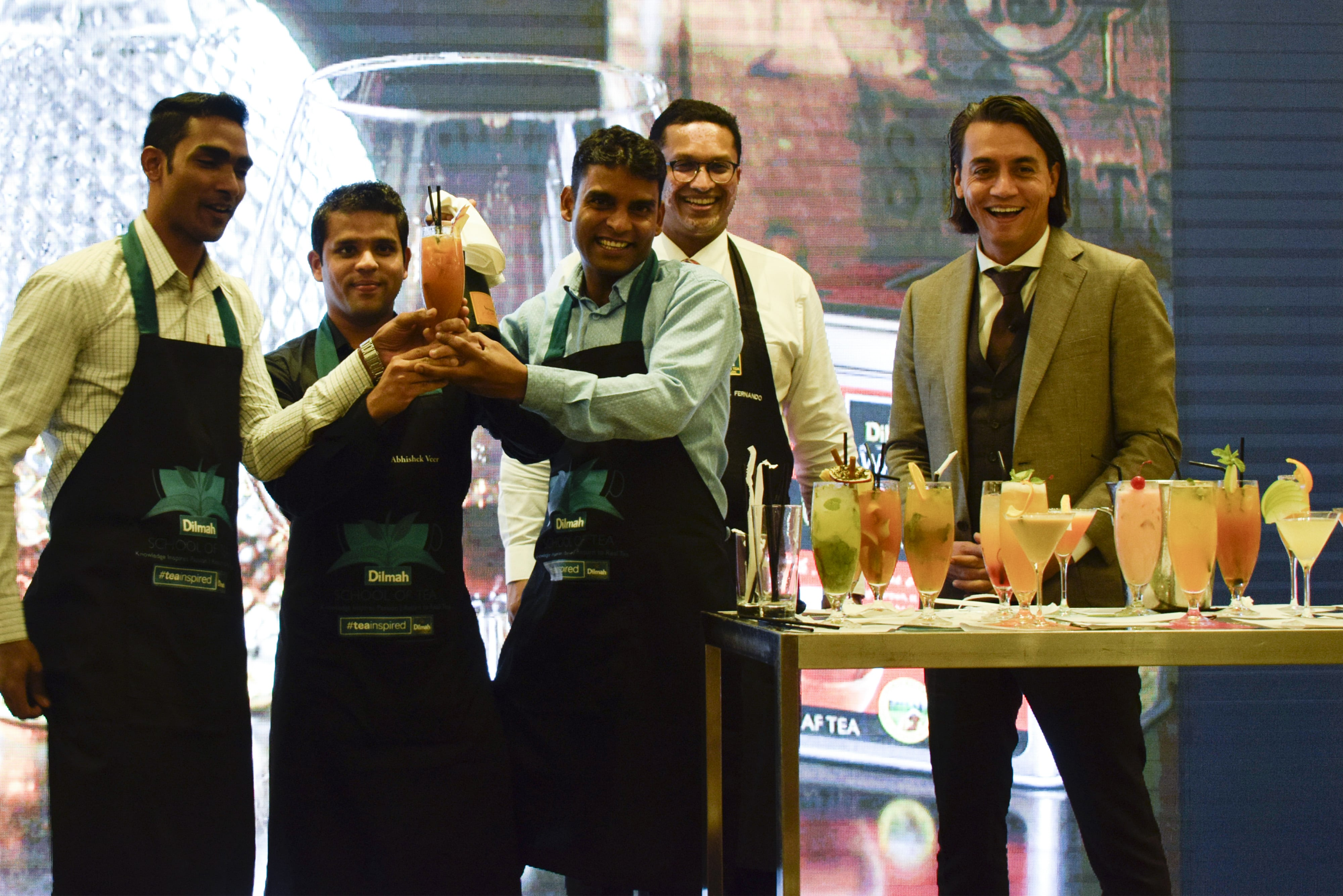 The winner of the best tea inspired drink receiving their prize