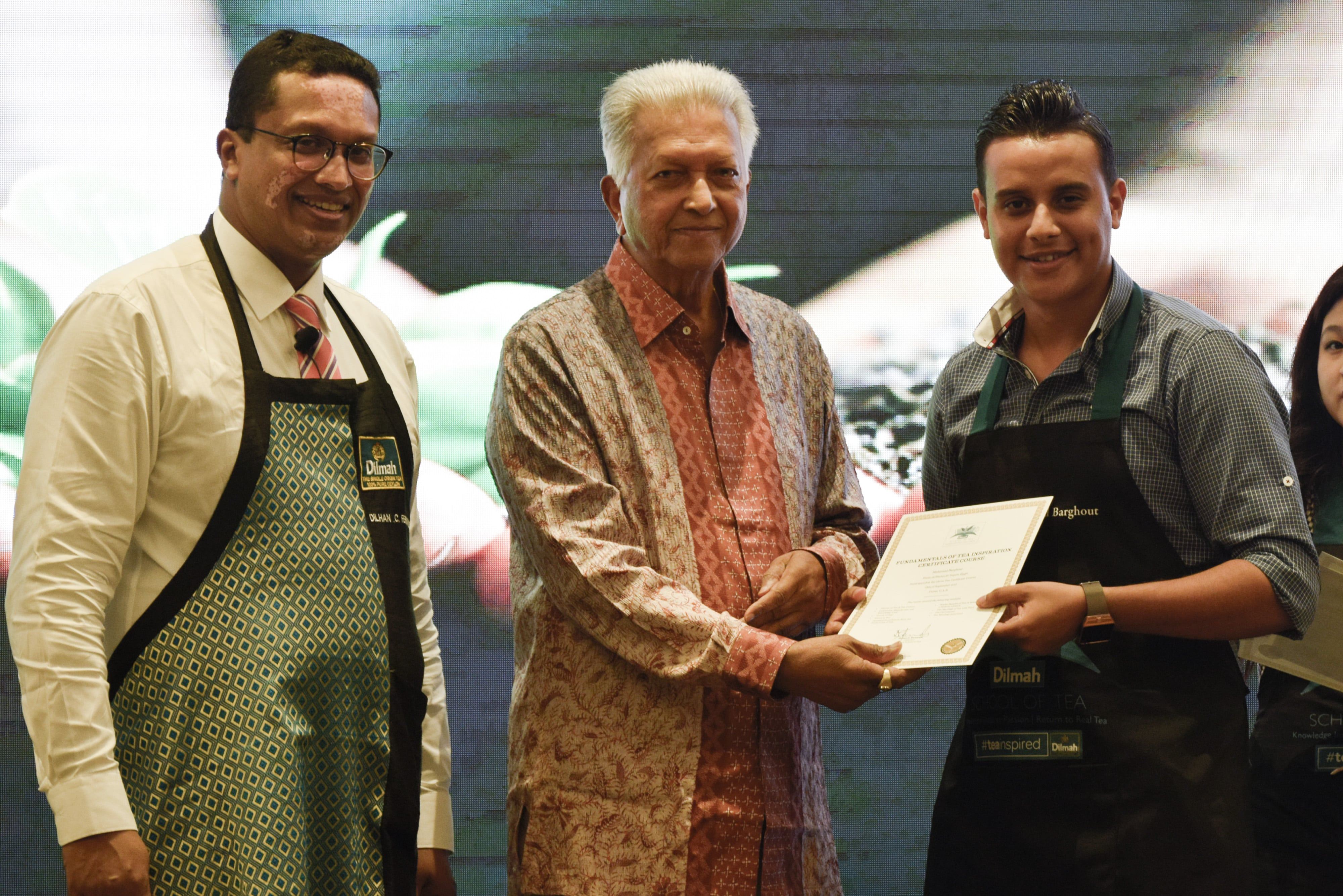 Founder of Dilmah presenting the certificates to the participants