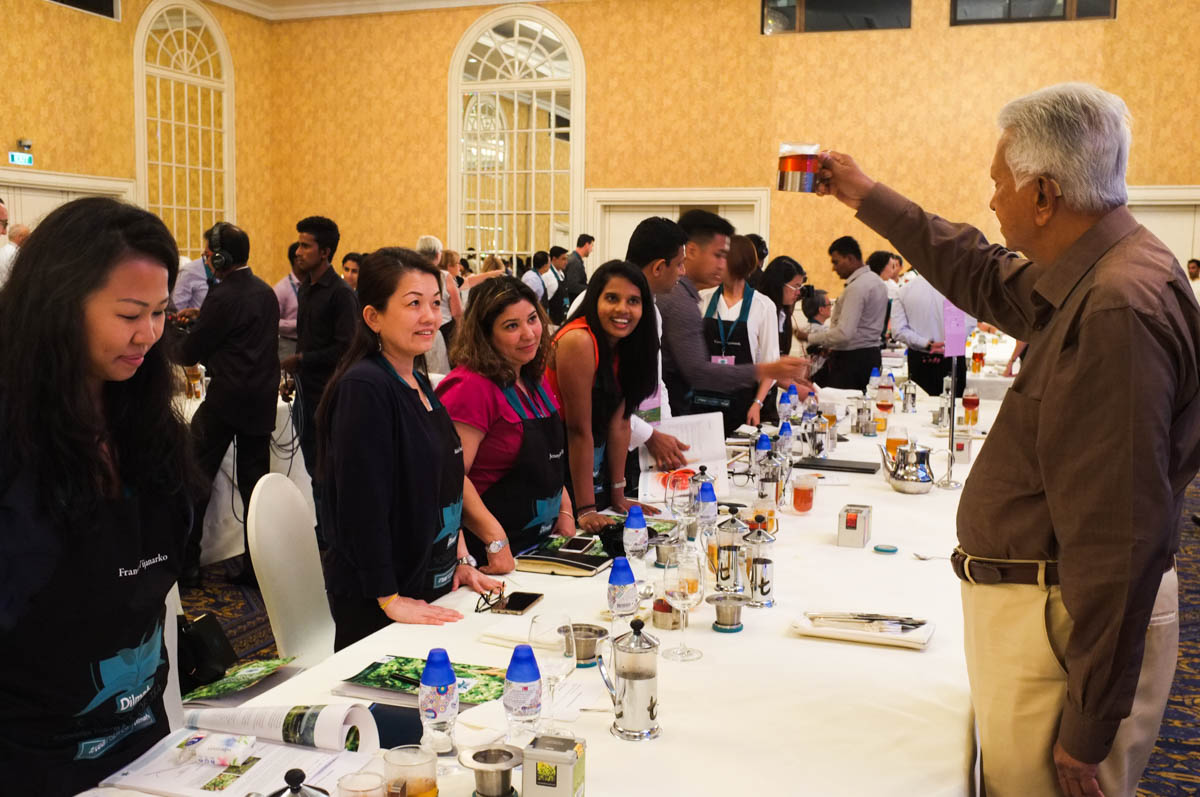 Founder of Dilmah evaluating the brewed tea of participants