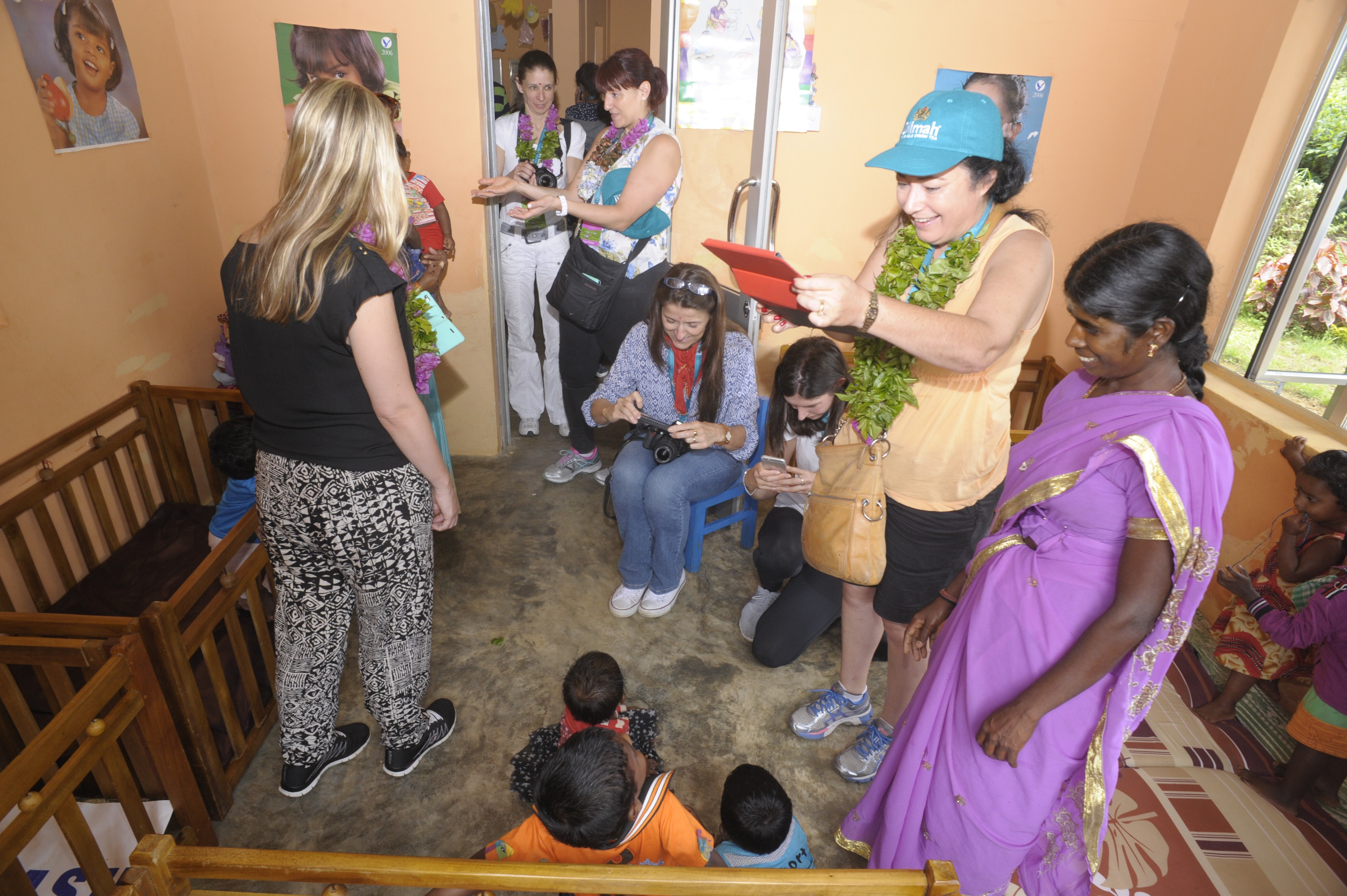 Participants interacting with kids at the Creche