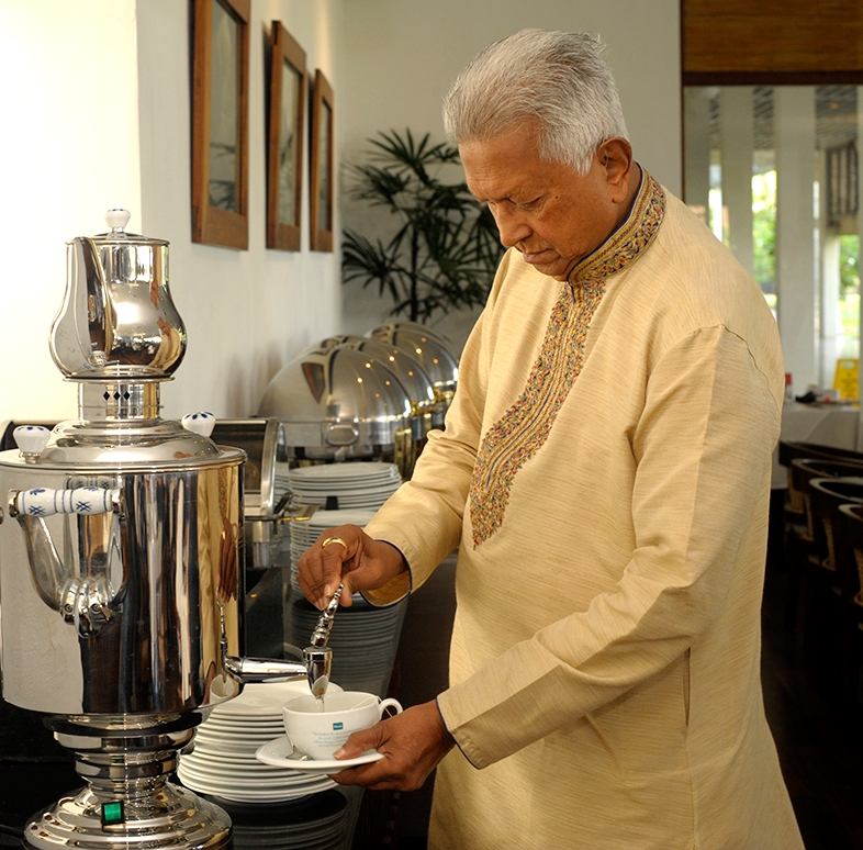 Founder of Dilmah brewing a cup of tea