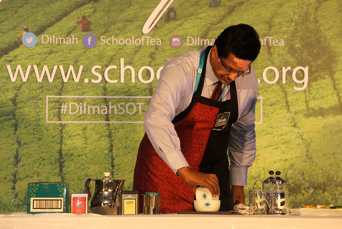 Dilhan C. Fernando demonstrating the science of brewing a perfect cup of tea