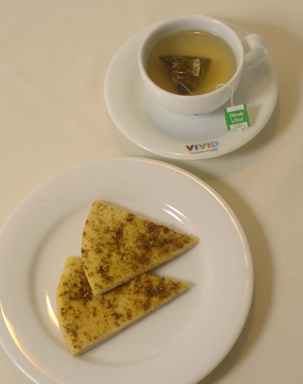 Zaatar bread with Naturally Pure Green Tea (Lemon & Syrup)