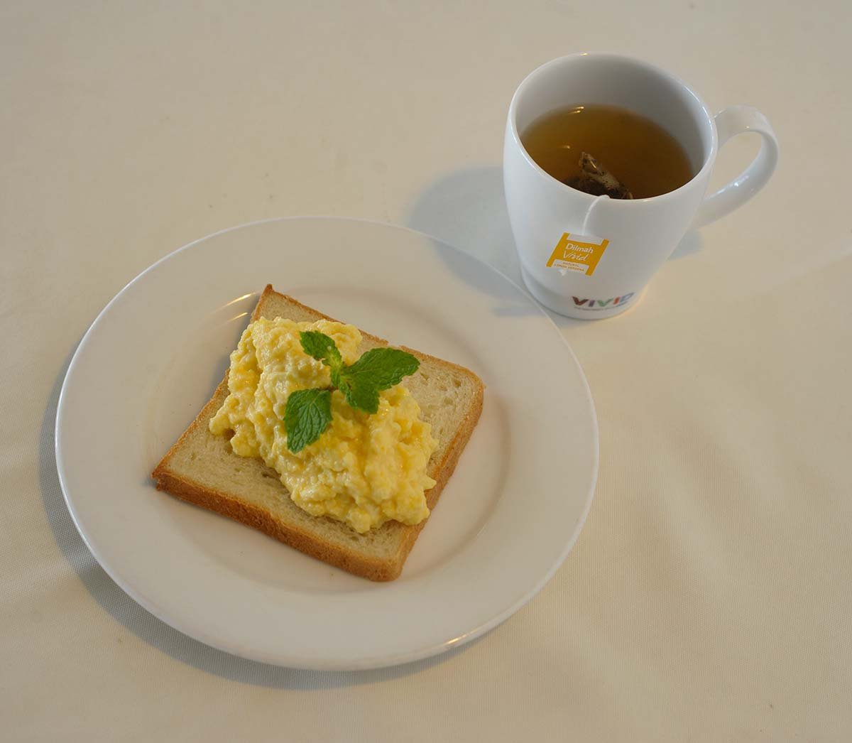 Natural Lemon Verbena with Poached or scrambled egg in butter & some milk