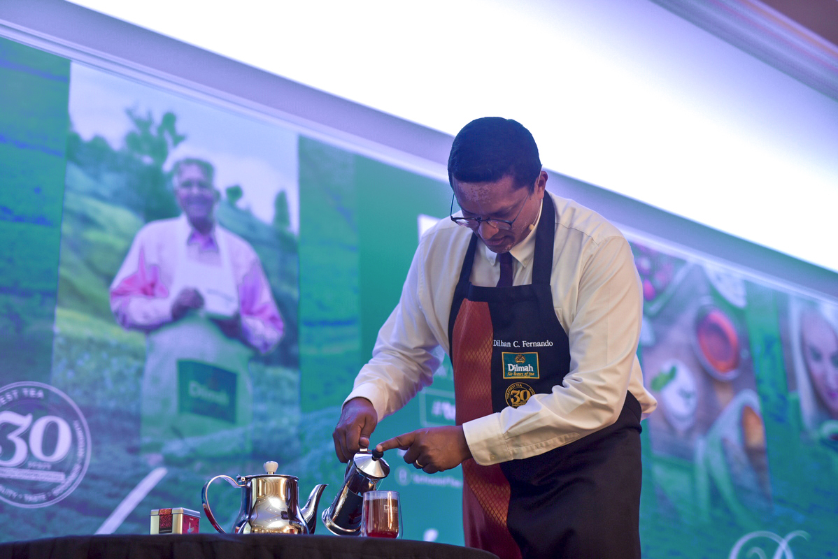 Dilhan C. Fernando demonstrating the techniques of brewing